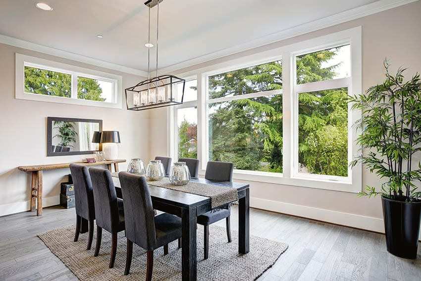 Modern dining room with beige paint color and large windows
