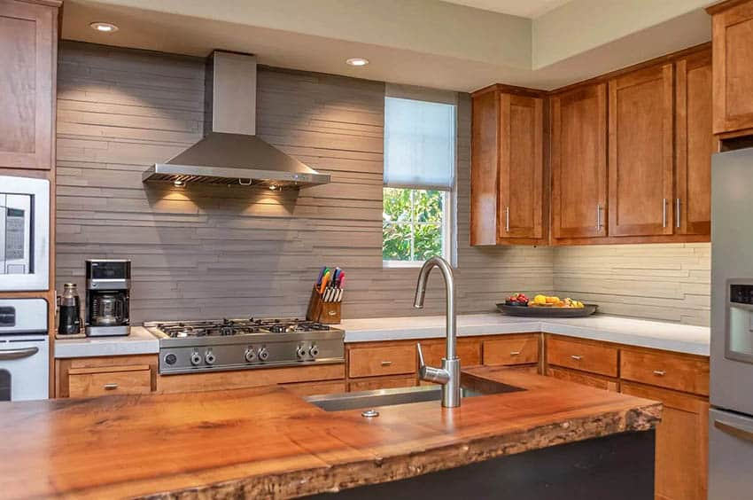 Modern kitchen with live edge wood countertop island quartz counters and gray backsplash