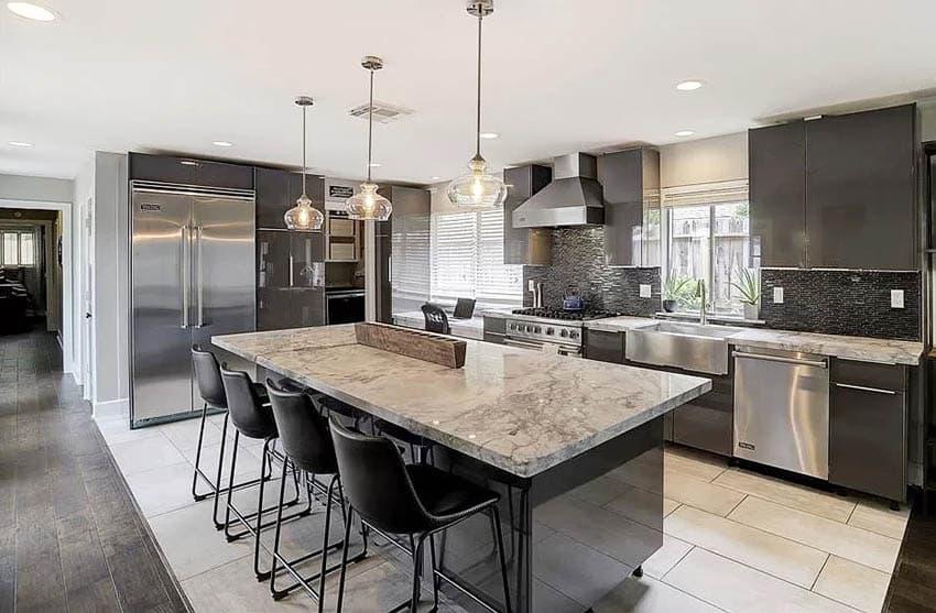 Modern kitchen with quartzite countertops black mosaic tile backsplash black gloss cabinets