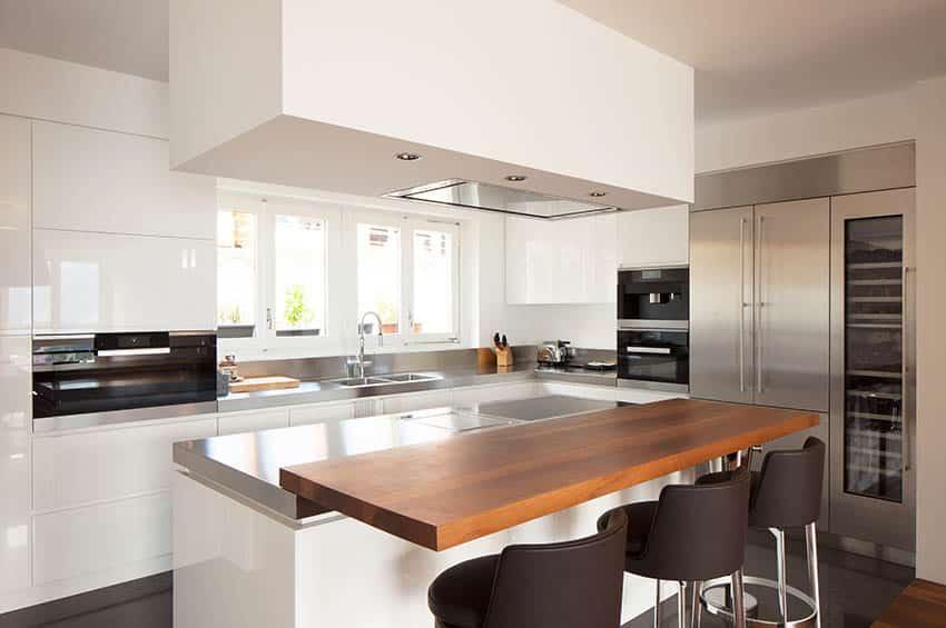 Modern kitchen with walnut countertop breakfast bar island