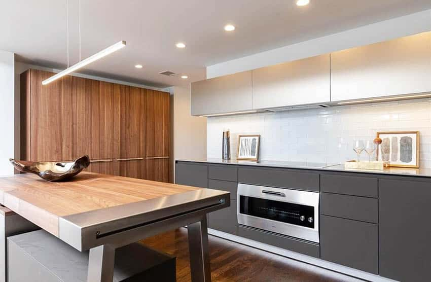 Modern kitchen with walnut island and quartz counters two tone cabinets