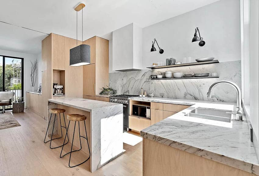 Modern kitchen with waterfall quartzite countertops backsplash bleached wood cabinets