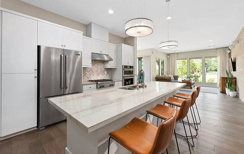 Modern kitchen with white cabinets quartzite countertops wood look tile flooring