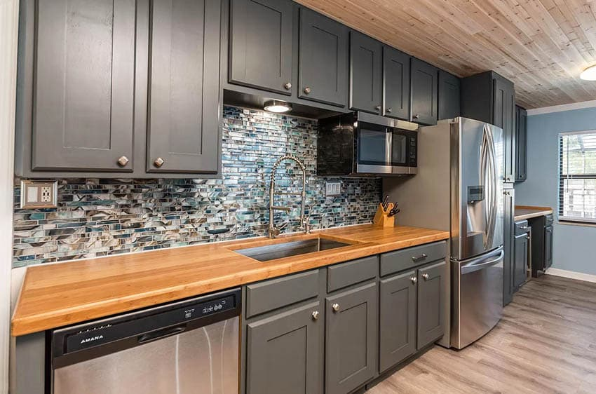 One wall kitchen with bamboo countertops dark gray cabinets
