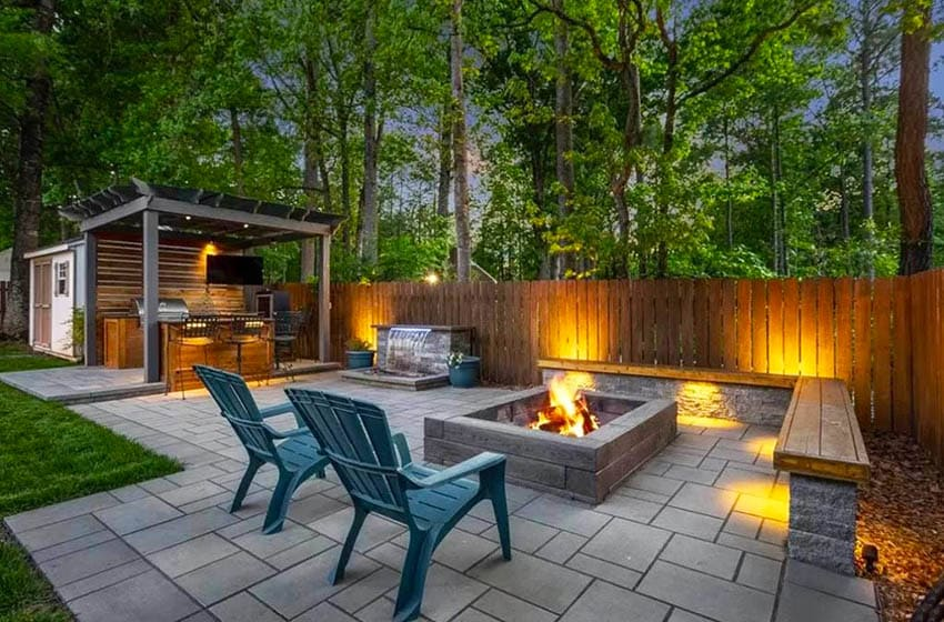 Paver patio with fire pit and outdoor tv under pergola
