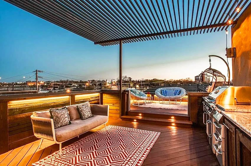 Rooftop deck with pergola outdoor kitchen lighting