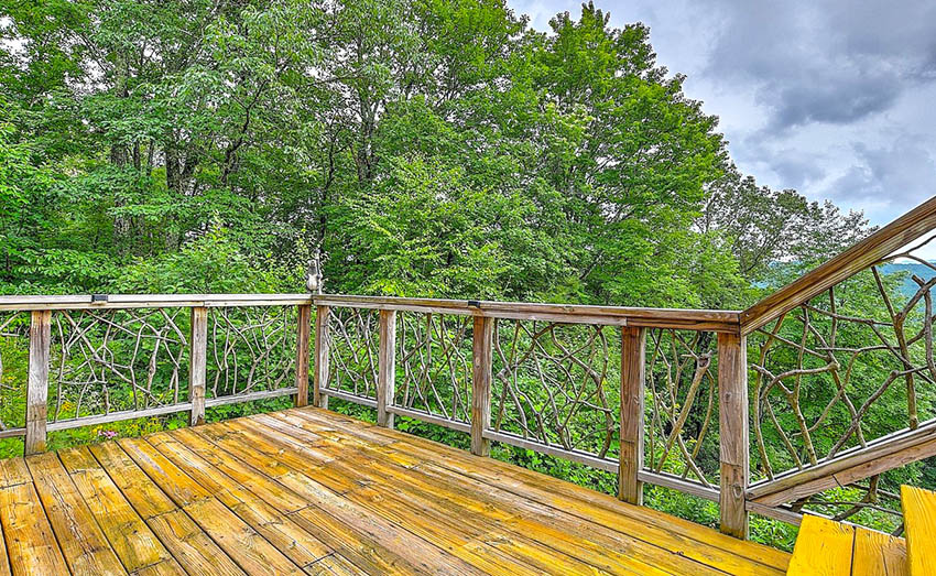 Rustic deck railing with decorative tree branches