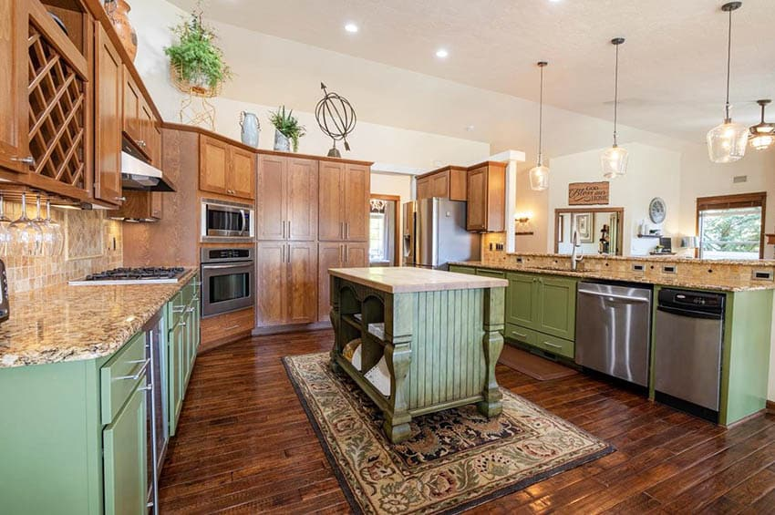 Rustic kitchen with green beadboard island and peninsula with wood cabinets