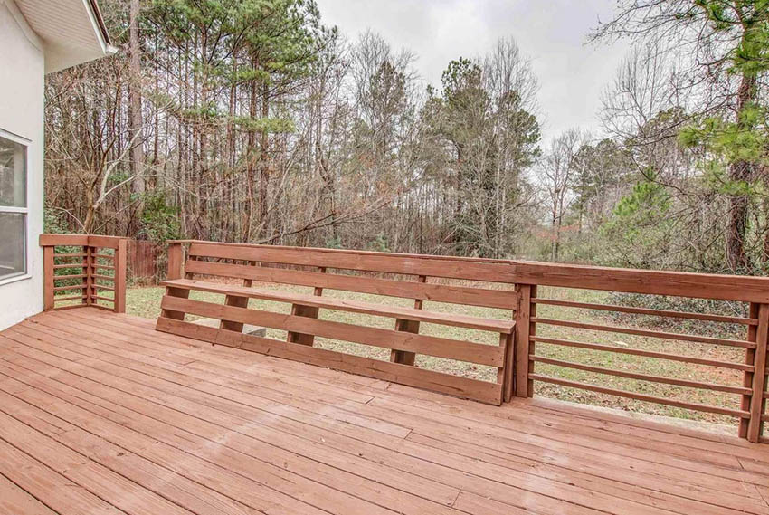 Rustic wood deck railing with bench