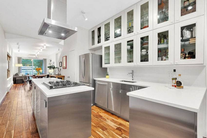 Small kitchen with island and peninsula stainless steel base cabinets