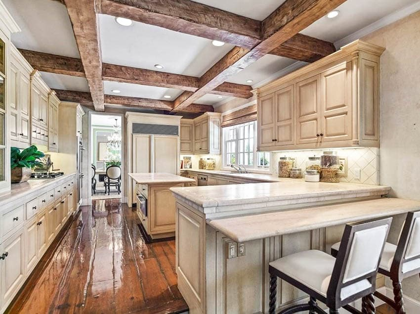 Traditional kitchen with island and peninsula wood beams and wood flooring