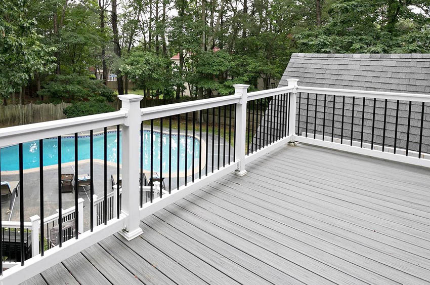 Traditional white vinyl and metal deck railing