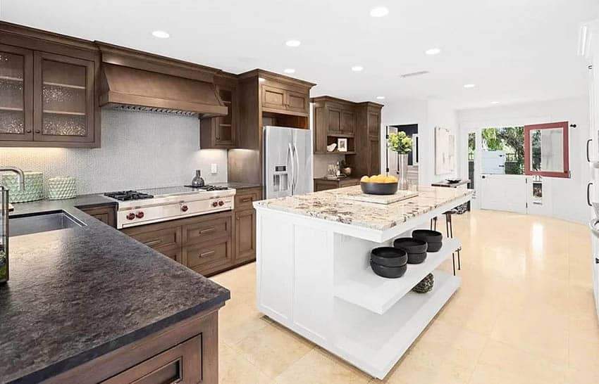 Transitional kitchen with dark cabinets with peninsula and white island with granite countertops