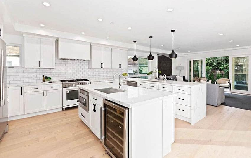 Beautiful transitional kitchen with marble countertop island & peninsula with black pendant lights