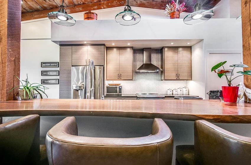 Transitional kitchen with reclaimed wood countertop island