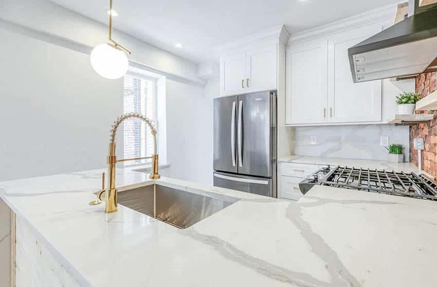 U shaped kitchen with calacatta quartz countertop white cabinets