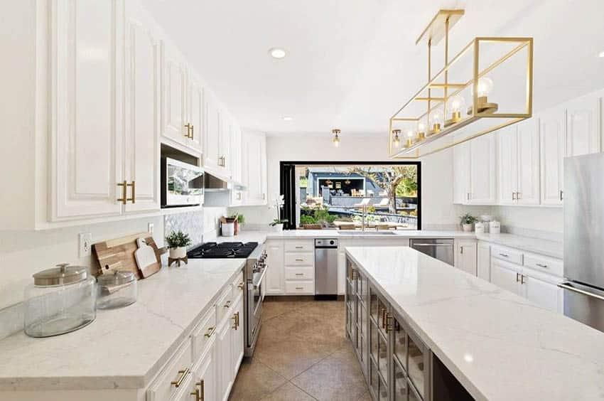 U shaped kitchen with long narrow island peninsula and marble countertops