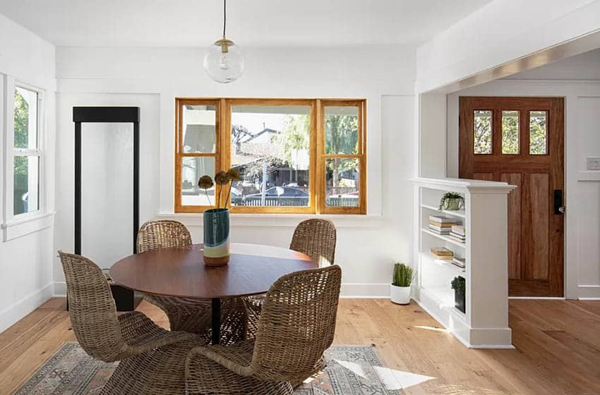 Bungalow home interior dining room with wood frame windows built in shelving divider