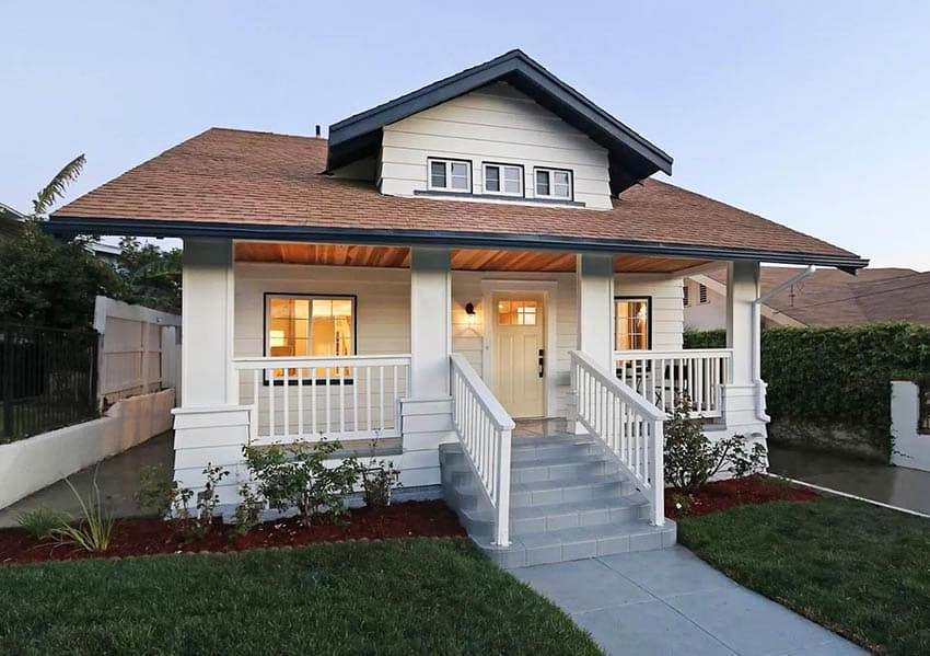 Bungalow style house with white fence porch