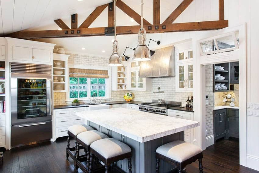 Cape cod kitchen design with white shaker cabinets pendant lights and butlers pantry