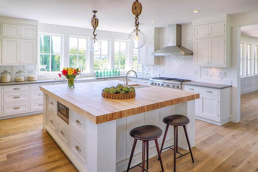 Cape cod kitchen with shaker cabinets quartz counters butcher block island nautical style light fixtures
