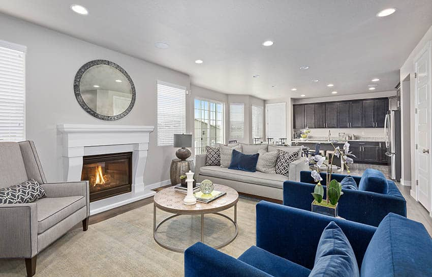 Family room with gas fireplace and white mantel