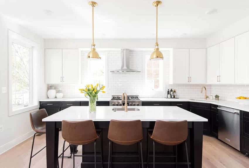 Gorgeous kitchen with quartzite countertops white and dark brown cabinets