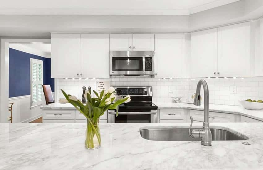 Kitchen with carrara marble countertop island white cabinets