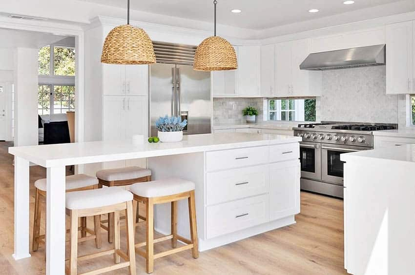 Kitchen with carrara marble countertops white cabinets basket shade pendant lights