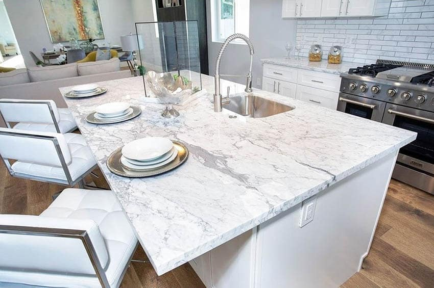 Kitchen with carrara marble countertops white cabinets