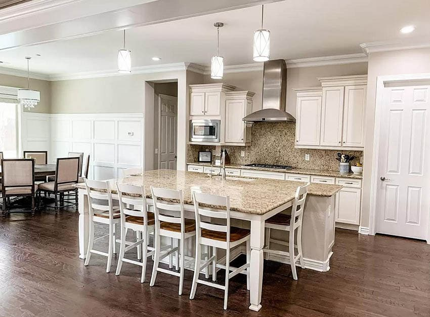 Kitchen with granite countertops and off white cabinets white wainscoting