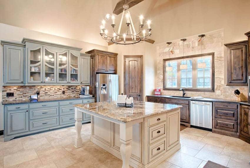 Kitchen with juparana vyara granite countertops three tone cabinets cream color island
