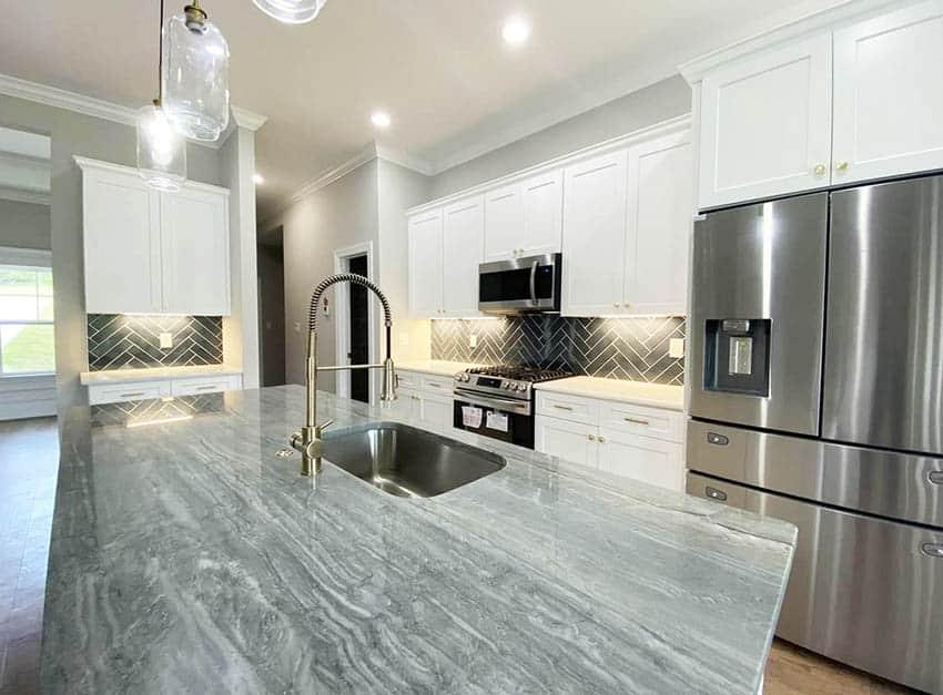 Kitchen with platinum velvet grey quartzite white cabinets