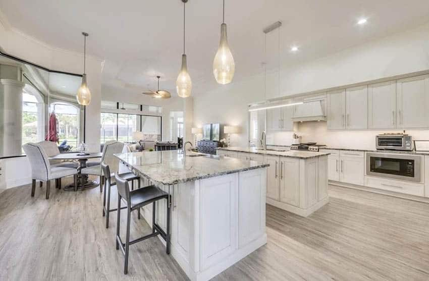 Kitchen with white washed cabinets and granite countertops