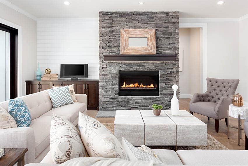 Living room with gas fireplace and stacked stone surround