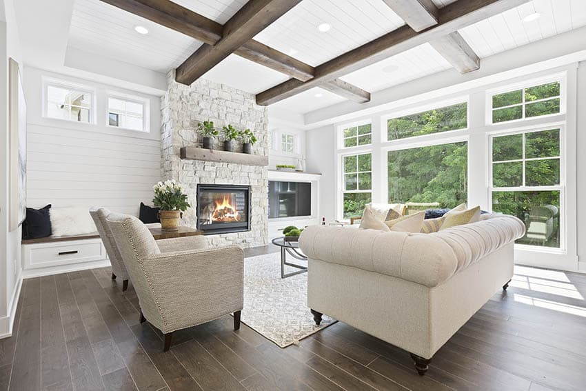 Living room with gas fireplace and wood mantel