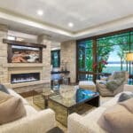 Luxury living room with gas fireplace and stone pillars