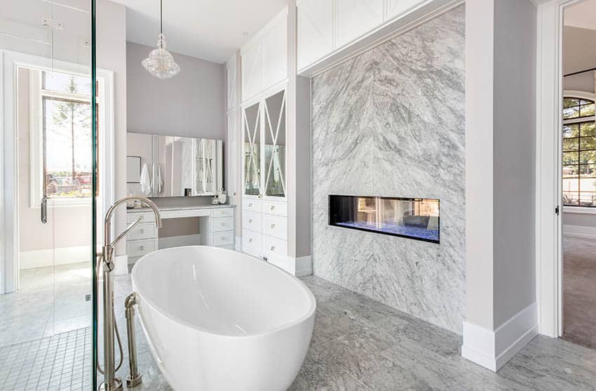 Master bathroom with gas fireplace and freestanding tub