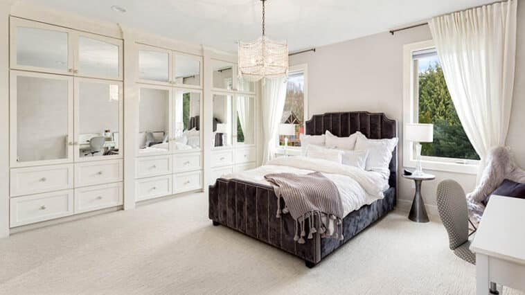 Master bedroom with built-in wardrobe with cabinets and drawers
