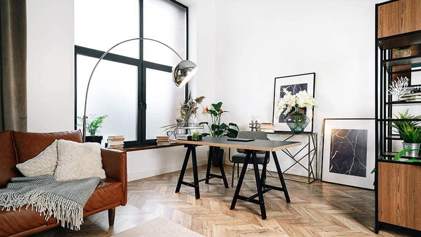 Modern home office with diy desk wood flooring and mid century modern lamp