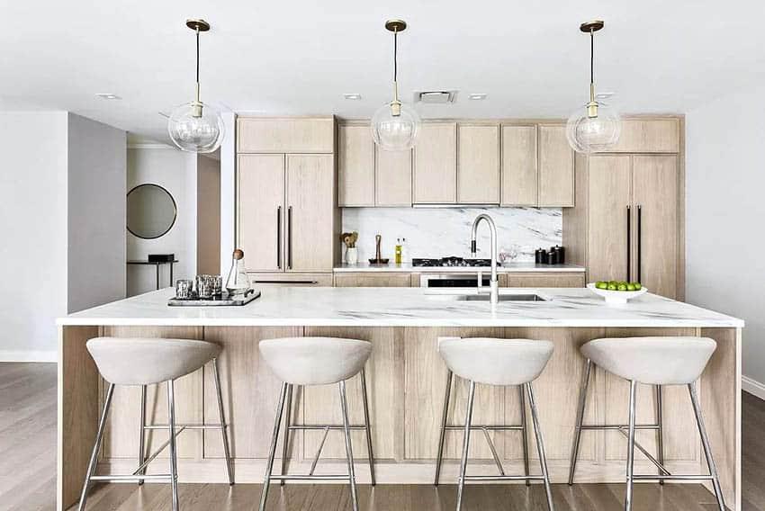 Modern kitchen with quartz countertops beige wood veneer cabinets globe pendant lighting