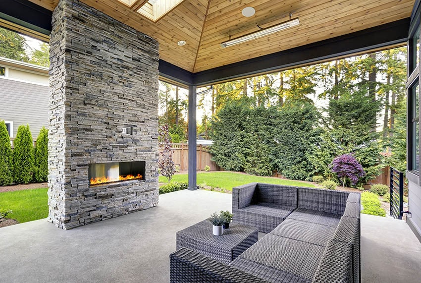 Epoxy patio with gas fireplace and stacked stone
