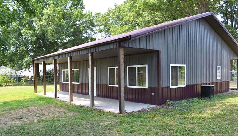 Pole barn house with metal design