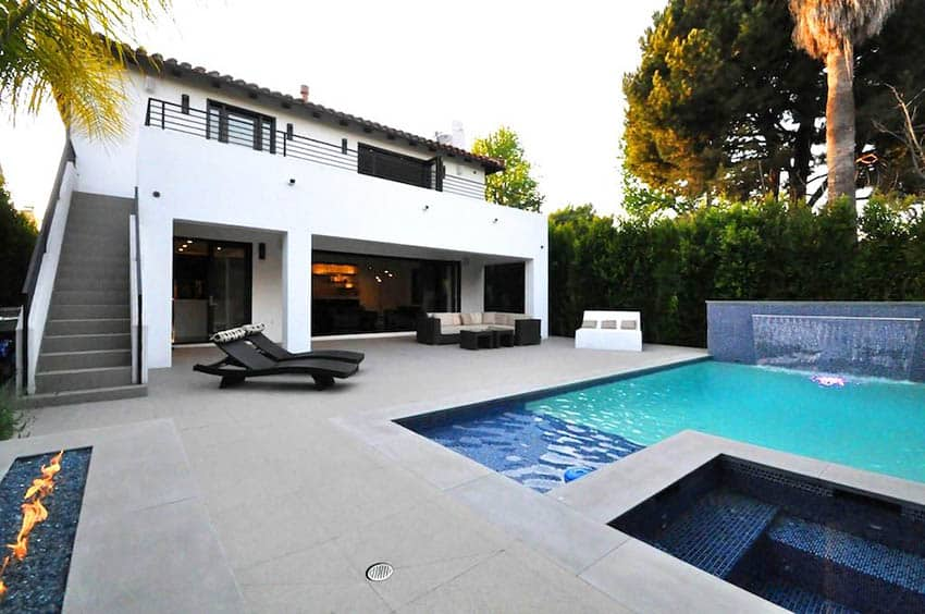 White stucco house with swimming pool