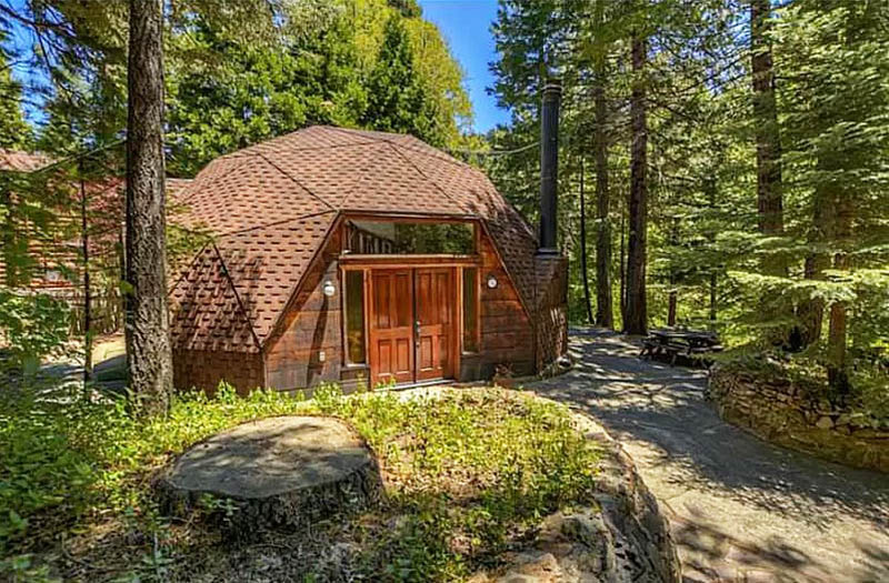 Wood geodesic home in forest
