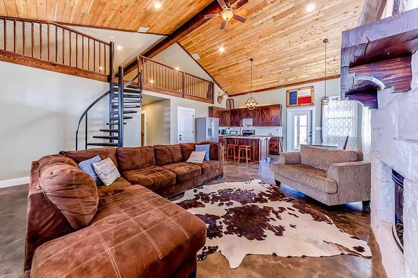 Barndominium interior with vaulted ceiling fireplace