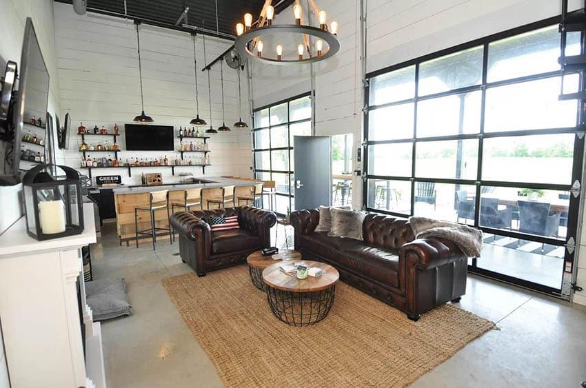 Barndominium living room interior with home bar garage roll up door