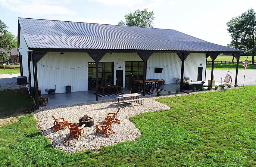 Barndominium with gravel patio and fire pit