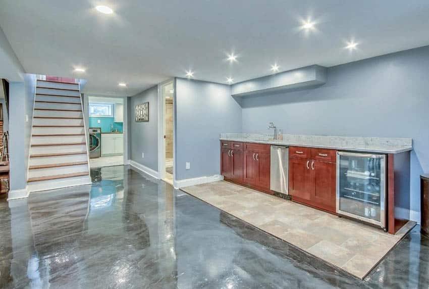 Basement with swirl epoxy resin floor home bar and tile floor