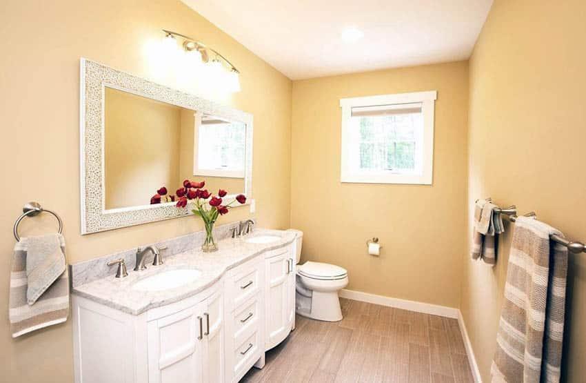 Bathroom with desert yellow paint and beige floor tile